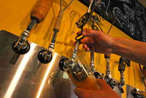 pouring a beer at BRU in Boulder