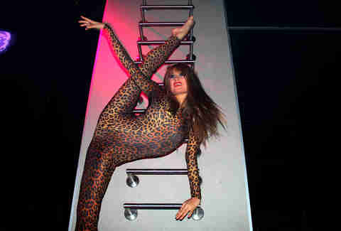 A leopard clad dancer stretches up a ladder at Haven nightclub at the Golden Nugget in Atlantic City