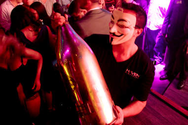 A masked server carries a 15 liter Nebuchadnezzar of Ace of Spades champagne at Haven nightclub at the Golden Nugget in Atlantic City