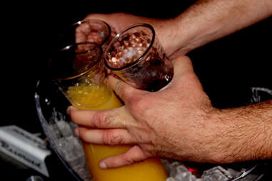 Hands grasping mixers at Haven nightclub at the Golden Nugget in Atlantic City