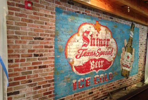 A Shiner ad on a brick wall