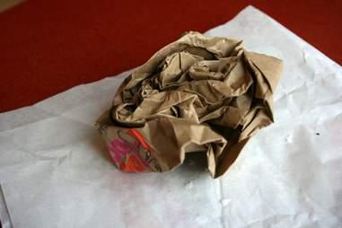 A crumpled Dunkin Donuts bag