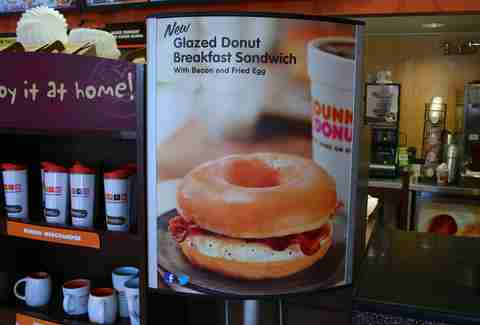 Dunkin Donuts glazed donut breakfast sandwich sign