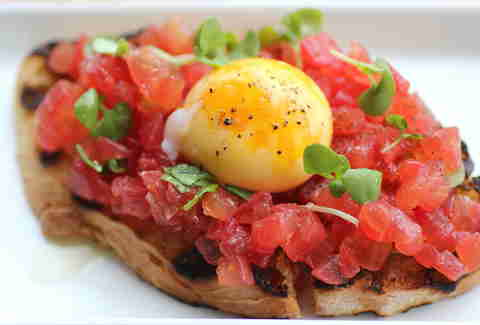 Tomato and egg yolk bruschetta at Terzo in Southwest Minneapolis