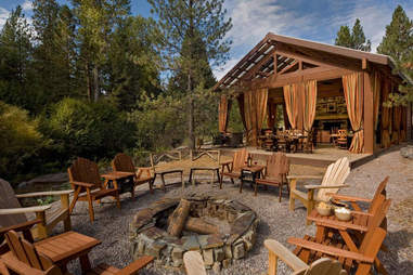Fire pit and dining pavilion at The Resort at Paws Up's Campside Creek