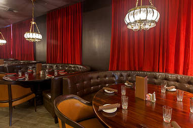 Leather booths in dining room at Carrie Nation Cocktail Club