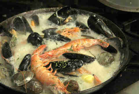 Clam, mussel, shrimp, and prawn shellfish waterzooi at Noord