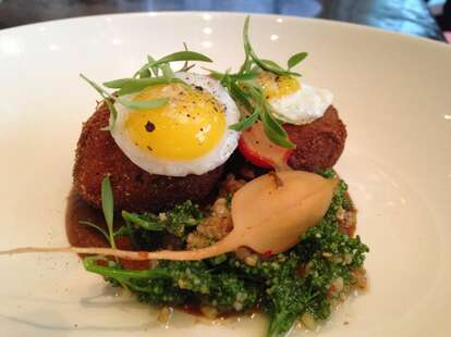 Cabeza Frita - crispy revival farm pig head, black bean mole, quail egg and pickled radish