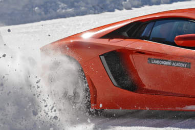 A Lambo showing snow the what for