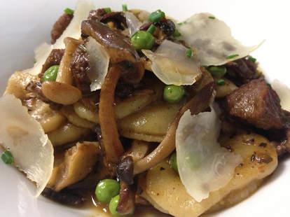 orecchioni pasta with beef ragu, mushrooms, peas, & pecorino cheese