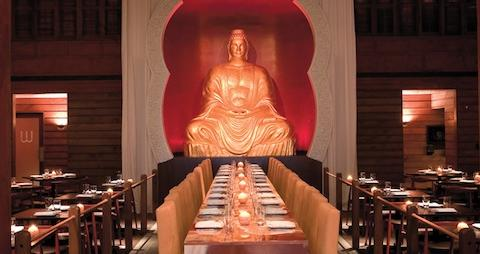 Buddakan interior, long table, large gold buddha