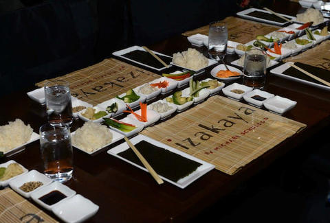 place mat, sushi, soy sauce, vegetables