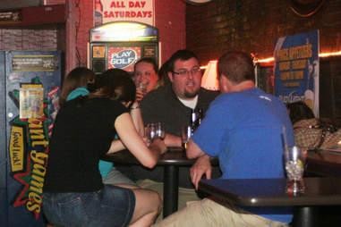 People drinking beer inside Courtside Karaoke in Cambridge, MA