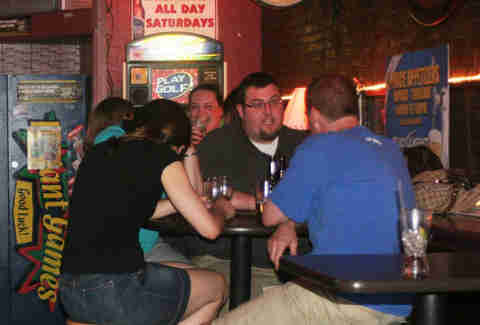 People drinking beer inside Courtside Karaoke in Cambridge, MA