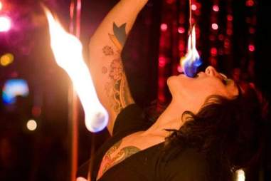 Woman eating fire at Devil's Point's Stripperoke in Portland