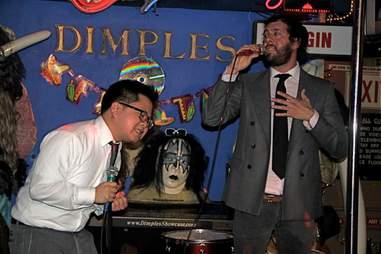 Man singing karaoke at Dimples in Los Angeles