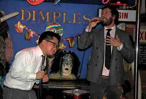 Man singing karaoke at Dimples in Los Angeles