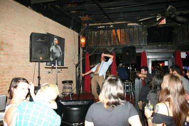 Man singing karaoke at Good Luck Karaoke in Dallas