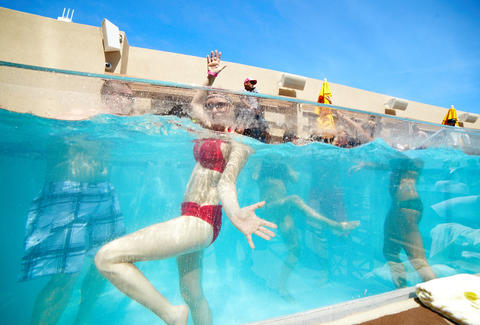 A girl dances in the bungalow plunge pool at HQ Beach Club at Revel