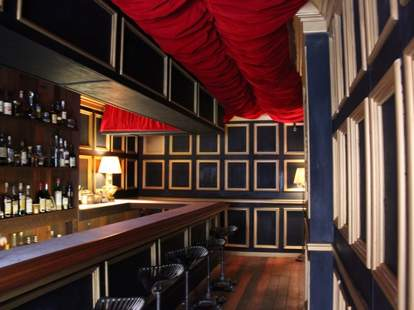 A bar with a red ceiling