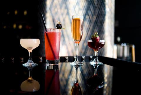 Four assorted specialty cocktails.