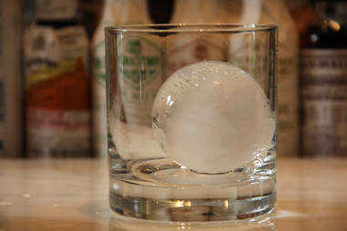 An ice ball in a glass at the Library Bar at the Rittenhouse Hotel
