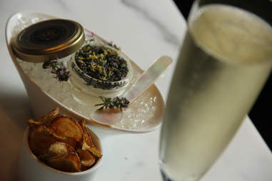The Dom Perignon, caviar, and potato chip pairing at the Library Bar at Rittenhouse Hotel