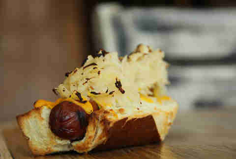 Sauerkraut and mustard topped rye pretzel bun dog at Farmer's Road in Chadds Ford.