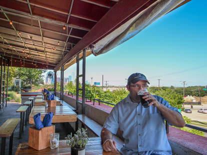 Thrillist Dallas Editor Aaron Miller enjoying a beer on a patio