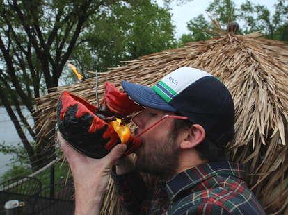 Thrillist Minneapolis Editor Drew Wood drinking from a lava bowl