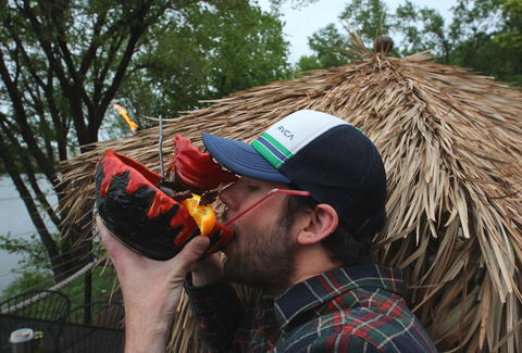 Thrillist Minneapolis Editor Drew Wood drinking from a lava bowl
