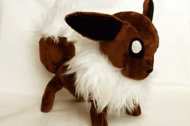 Plush Goat with demon eyes