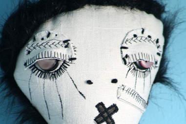 Robert Smith-looking doll
