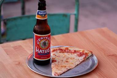 Slice and beer at Mansini's Pizza House