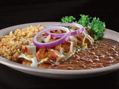 Chicken fajita enchilada with beans and rice