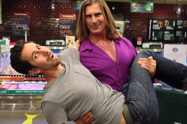 Fabio holding a man in a Whole Foods