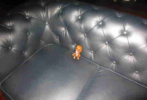 Sackboy on leather couch