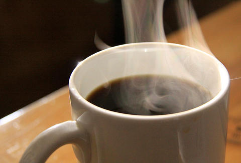 A steaming cup of coffee.