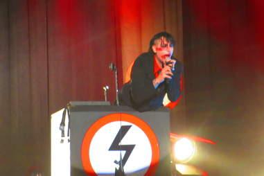 Marilyn Manson behind a podium