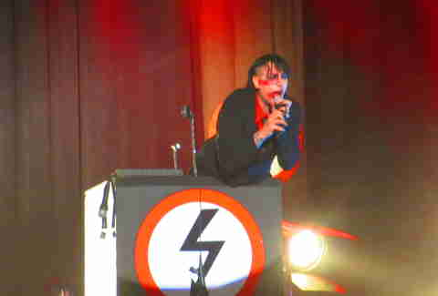 Marilyn Manson behind a podium