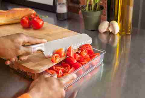 Cutting board containers with tomatoes