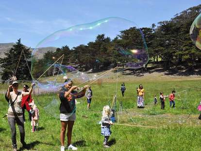Kids making bubbles at Headlands