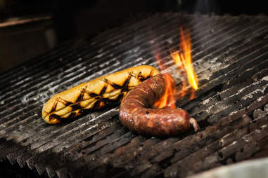 Grilling a ribeye sausage at Salt and Cleaver in San Diego.