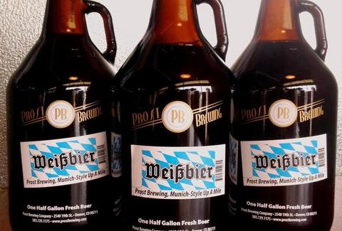 Three growlers of beer with the Prost logo.