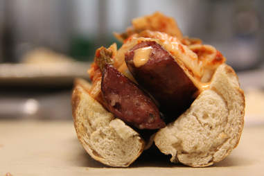 The hot dog at 10 Arts at the Ritz Carlton Philadelphia topped with Kimchi sauerkraut