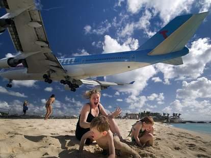 women and children cower at St. Marteen airport
