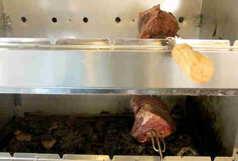 The rotating skewers of beef inside the Braz BQ Truck