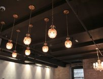 Boutique light fixtures shaped like crystal flowers hang from the ceiling.