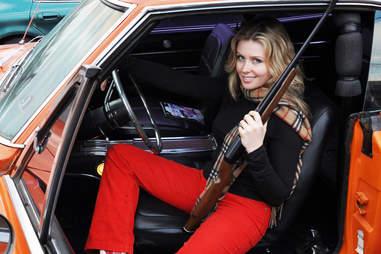 Georgia Pellegrini holding a shotgun