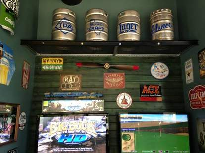 A wall of games and kegs at Addison Ice House
